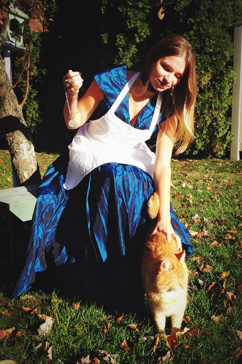 """Lauren of """"Playing Martha"""" as Alice in Wonderland with our random Cheshire Cat neighbor"""