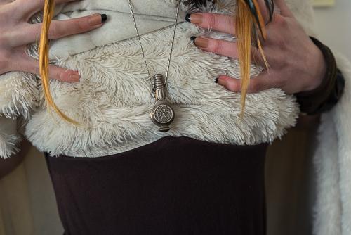 Blanket/coat tucked into the underbust corset