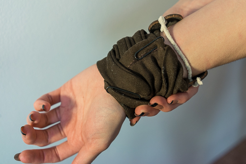 The glove was held in place with paper clips, and the detailed accessory by a pipe cleaner