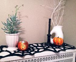 black felt Halloween runner over a white radiator cover