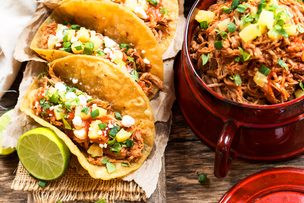These tacos are the perfect summer comfort food! From sweet to salty, and a little spice this meal will have your mouth watering. Toppings include cilantro, goat cheese, green onions, and pineapples of course!   Photography and recipe found at:  glutenfreewithlb