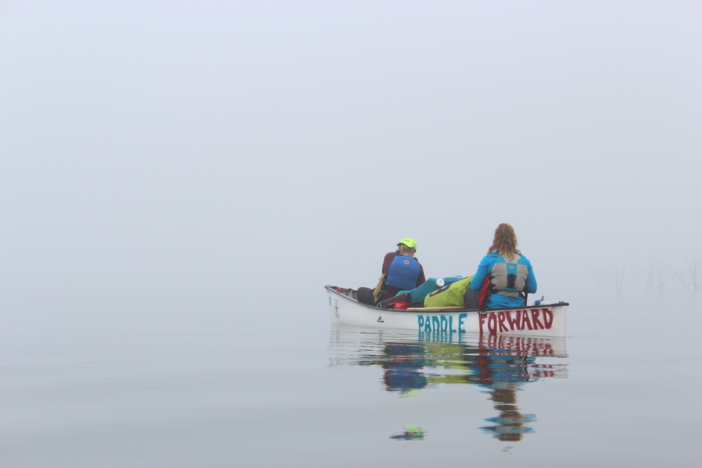 Liz and Erika paddling through the fog
