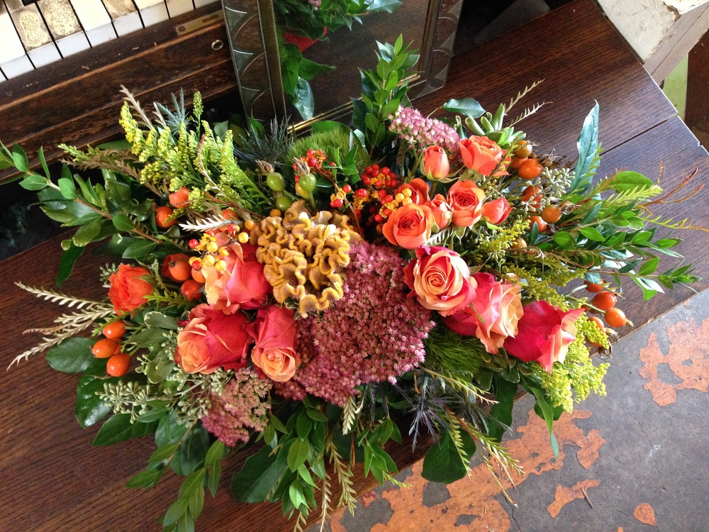 Lush autumnal arrangement is perfect for banquet tables and mantels