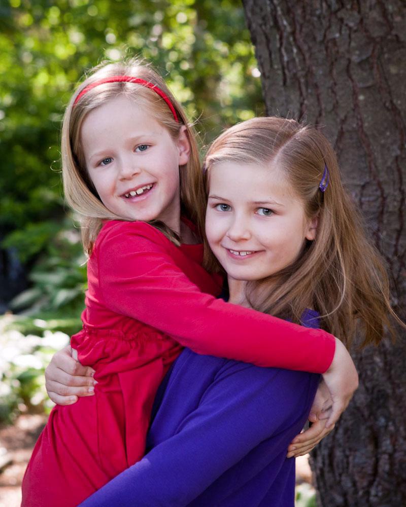 Concord_portrait_garden_girls_redandblue_hugx.jpg