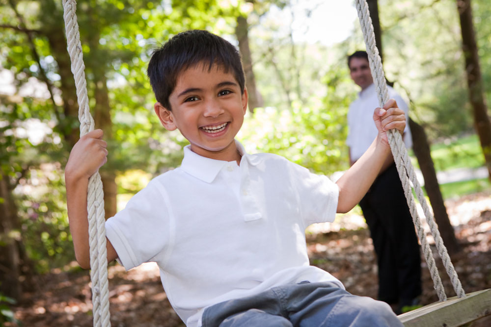 Concord_portrait_garden_younber_boy_on_swingx.jpg
