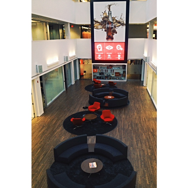 Sofas by Alison Spear form conversation circles in the central atrium.