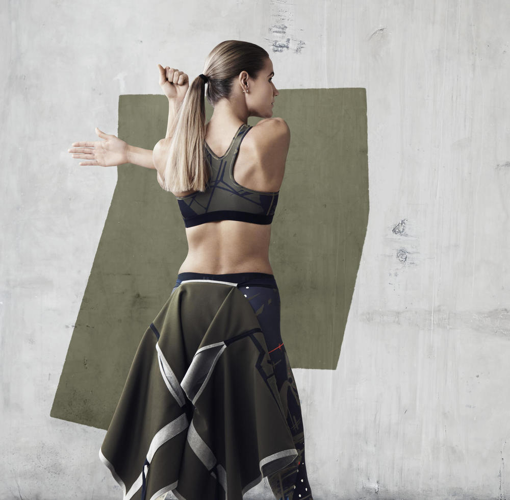 Lithuanian High Jumper, Airinė Palšytė, wears NikeLab x JFS Printed Bra, NikeLab x JFS Sleeveless Cape and NikeLab x JFS Printed Tight.