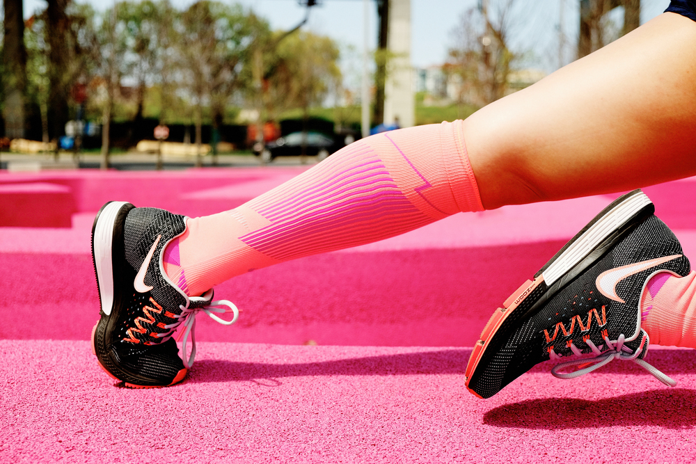 Christina wears: Nike Elite Compression OTC Running Socks, and Nike Air Zoom Vomero 10's