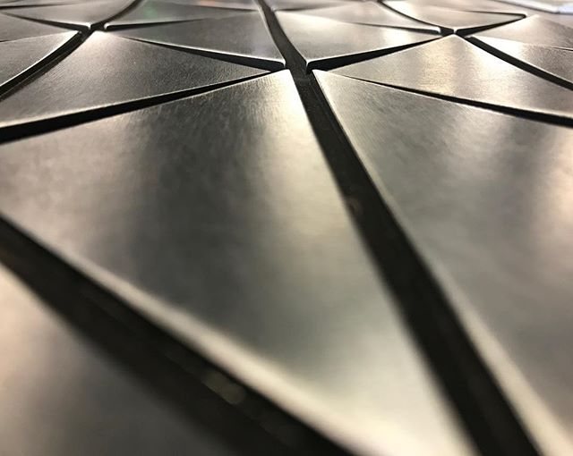 Playing around with patterns and subtle curvature for our newest design. This sample is made from aluminum, can't wait to see the real deal in brass 😍