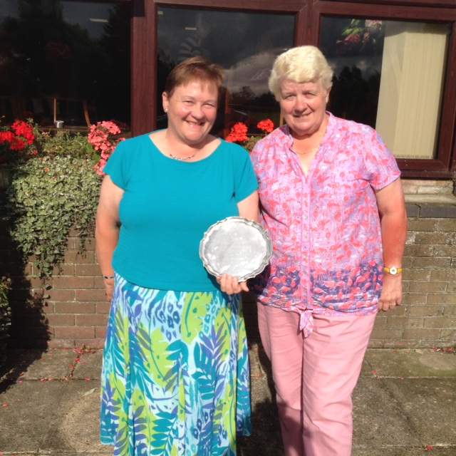 Julia Calver (Left), receiving her prize from Lady Captain Carol Brown.
