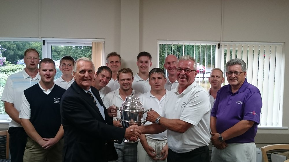 Pictured is County Vice President, Colin Firmin, presenting the Tolly Cobbold Cup to the Rookery Park Golf Club winning team captain, Allan Holmes.