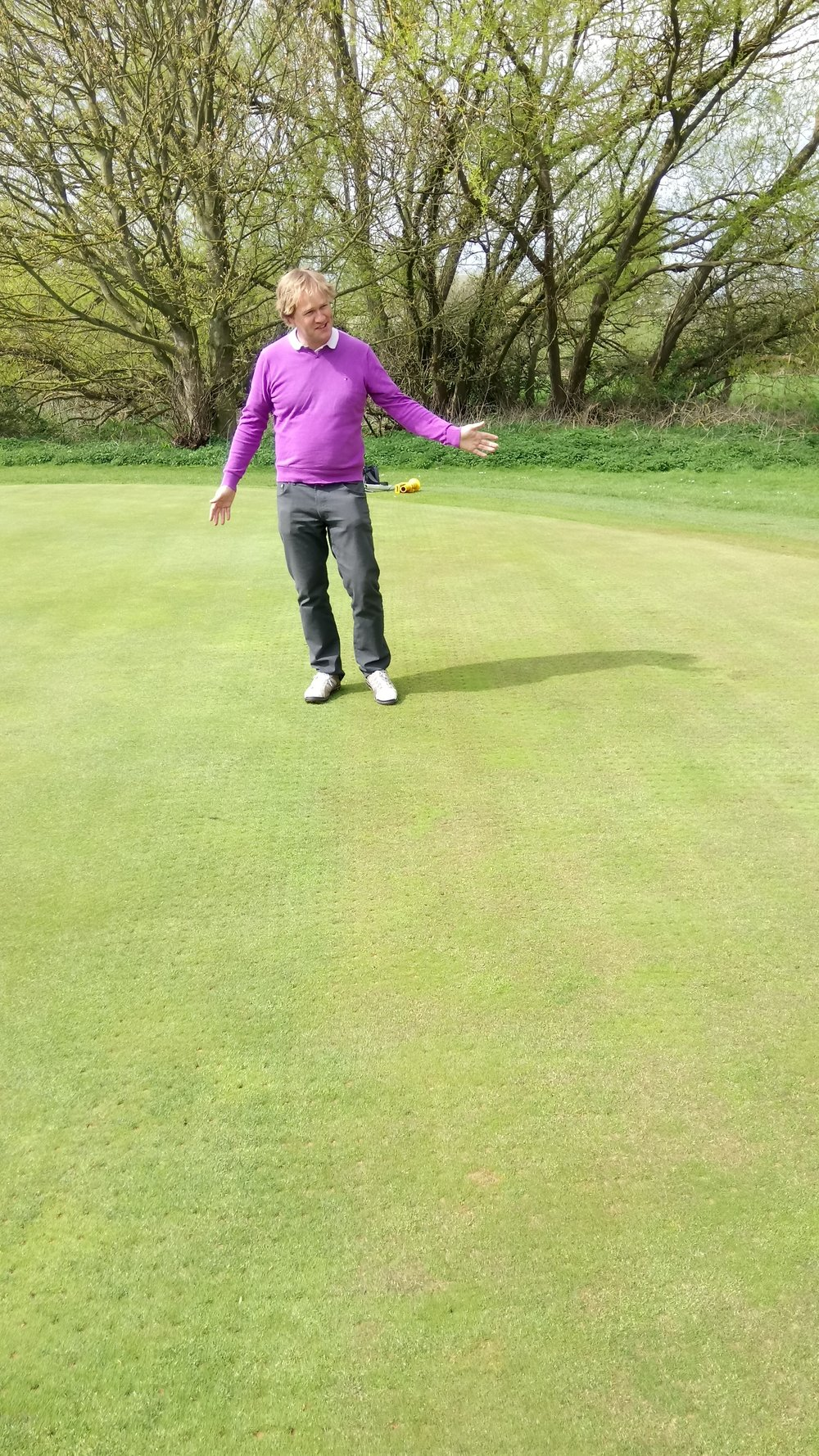P Armitage assessing the Club's Rescue trial on the 8th green. The area where Philip is standing and to the right of where Philip is standing has been treated with Rescue, the course grasses have now discoulored and are stating to die, the bent grass applied before the Rescue was applied has already started to germinate. Philip was delighted with the success of the trial and has recommended that the Club applies Rescue to all of the greens during the annual greens maintenance week in August.