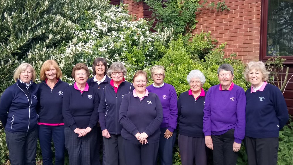 Left to Right: Judy Taylor, Rosie Earl, Wendy Sherwood, Shirley Walding, Rita Mayn (Lady Captain), Julia Calver (Non-Playing Captain), Freida Waldron, Pat Powell, Jenny Ives, & Yvonne Maclean.