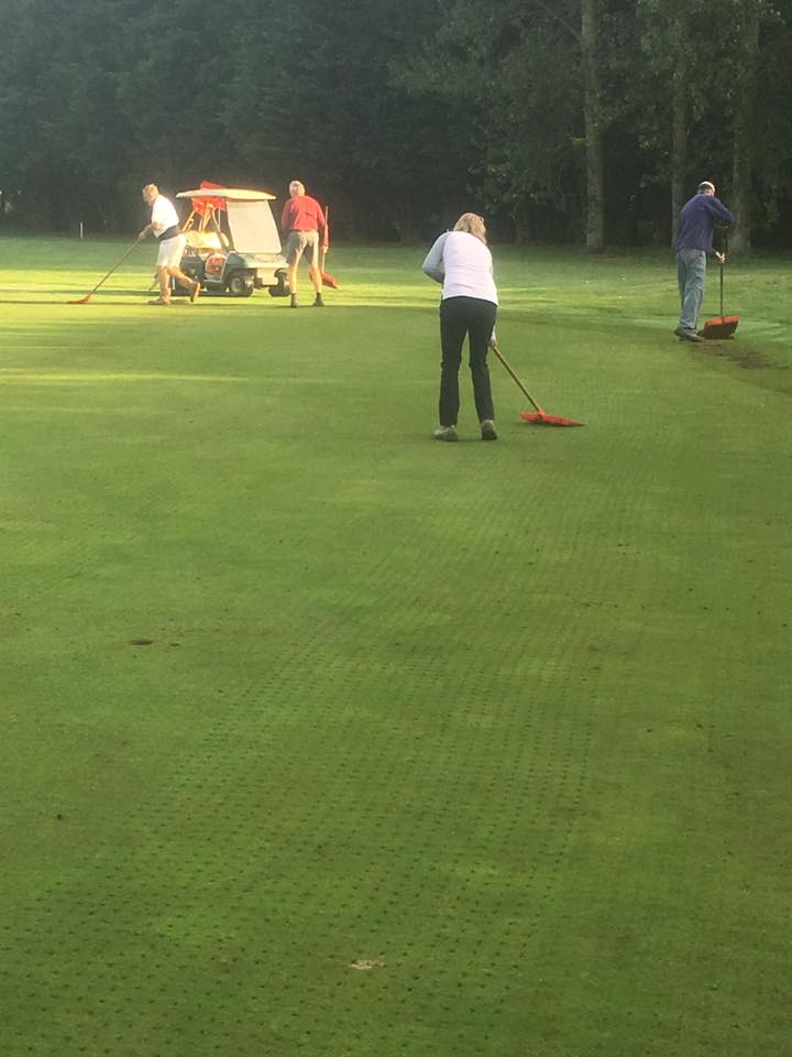 Volunteers Clearing Cores on the 14th Green