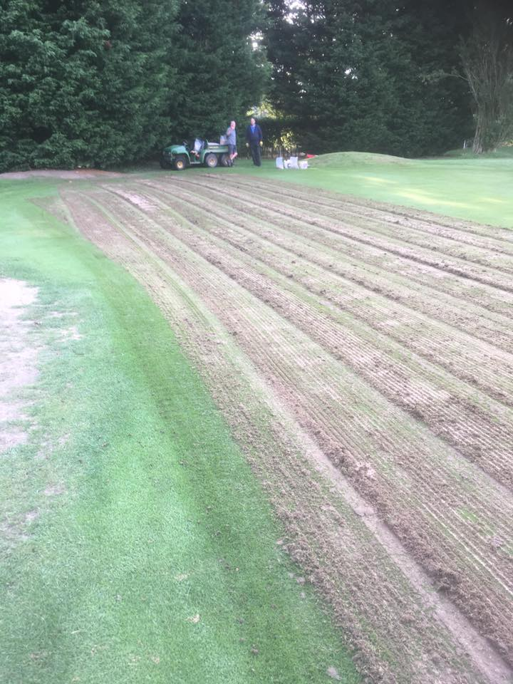 1st Green: Half the green has been scarified, staff and volunteers helped fill up the Graden machine after each pass