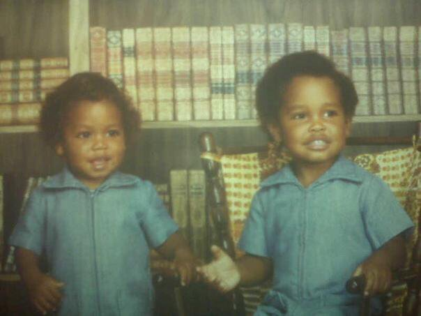 My brother Phillip and I in our mom-made jumpsuits, with afros parted on the left lol
