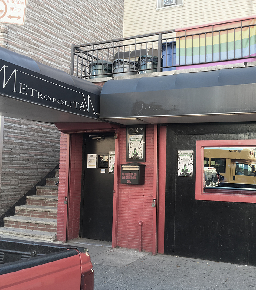 "METROPOLITAN 559 LORIMER STREET, BROOKLYN, NY HOSTED GIRL'S NIGHTS ON WEDNESDAYS FROM 2002-2015 (METROPOLITAN, PICTURED) ""Walk past the low-ceilinged bar, the jukebox and the pool table. Keep going, beyond the stage where 'Queeraoke' erupts every Tuesday, and right out the back door. Feel the sunshine on your face and inhale the relatively fresh air (this is New York, after all) that makes Metropolitan the most popular gay hangout in Brooklyn on summer Sunday afternoons.For the past nine years, casual backyard cookouts every Sunday from Memorial Day to the end of September (this year, to early October) have drawn local and farther-flung devotees to this small oasis, at 559 Lorimer Street in Williamsburg, a few steps from the L and G trains at Lorimer Street and Metropolitan Avenue. Here, buying a $2 Bud will get you a ticket for a free burger (or a veggie version), potato salad and a relaxed evening that is the antithesis of the high-priced, high-strung New York gay life celebrated on the reality show 'The A List.' 'It reminds me of places I would go in Berkeley or San Francisco,' Damon L. Jacobs, a marriage and family therapist, said at one recent gathering. 'More homey, cozy fun than the pristine, plastic scenes one might get in Manhattan.' While women may be in the minority at Metropolitan, they are by no means unwelcome — lesbian or straight. The bar creates special events for its various constituencies, said Troy Carson, the owner and manager of Metropolitan and Sugarland, another bar in Williamsburg. Ms. Carlson frequently attends Girls, Girls, Girls, Metropolitan's Wednesday night lesbian party, whose patrons she described as 'gays, whatevers, lesbians, everybody.' The bar also hosts craft-making workshops on Saturday afternoons and twice-monthly comedy nights."" (Hugh Ryan, The New York Times, 2011)"