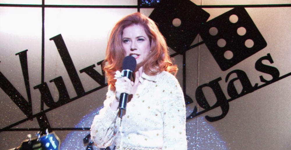 Maggie Moore impersonating Ann-Margret on the L Word (Season 3, Episode 2) which aired from 2004 to 2009. Image still from the L Word.