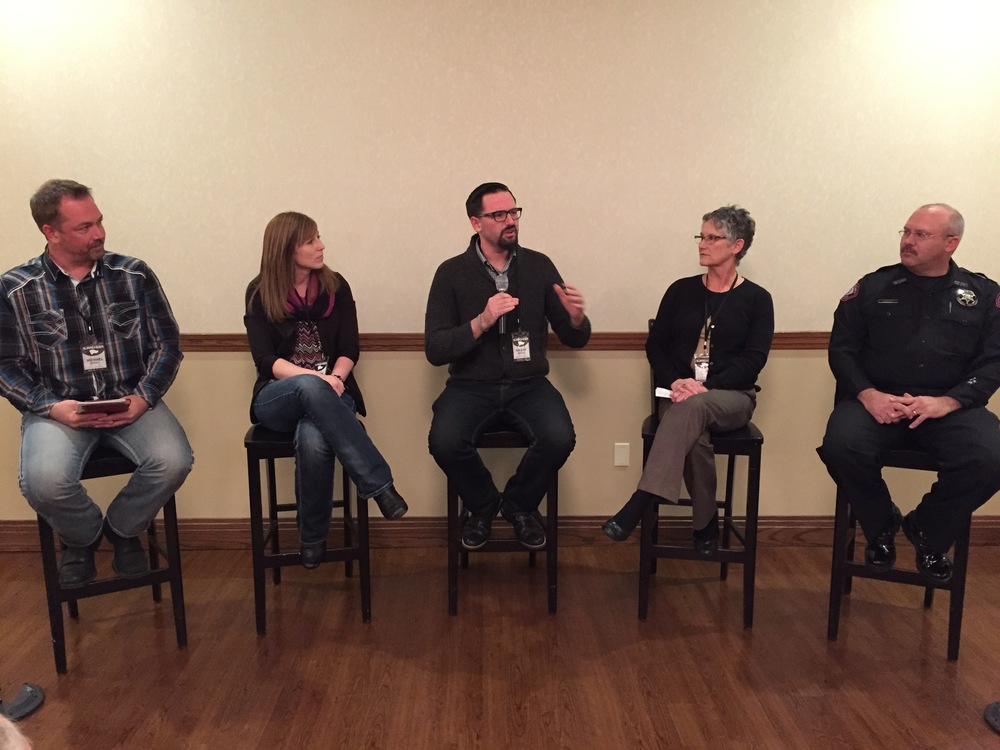 Raleigh Sadler in the center speaking on a panel concerning the role of the church in fight human trafficking in Springfield, Missouri .