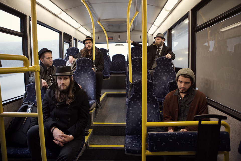 Tired boys on a bus - Photo by Rebecca Joelson