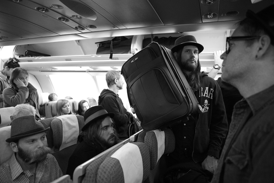 Tired boys on a plane headed home - Photo by Rebecca Joelson