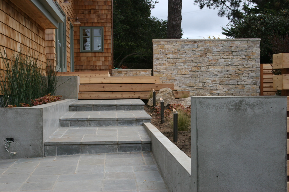 We built these concrete elements at the entry. Looks good with the slate path.