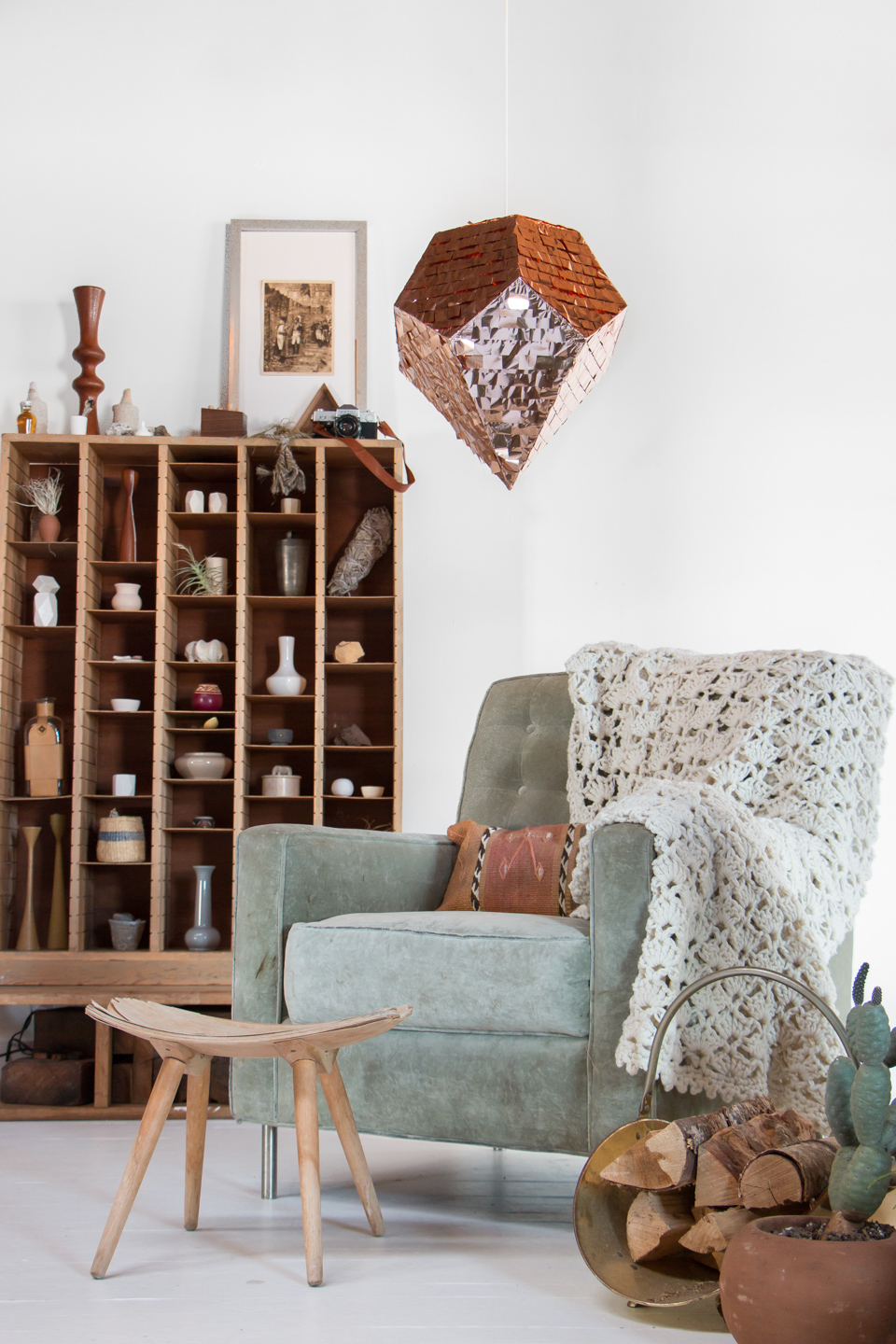 A  Bling Piñata  presides over a cozy reading nook with reminders of travels abroad.