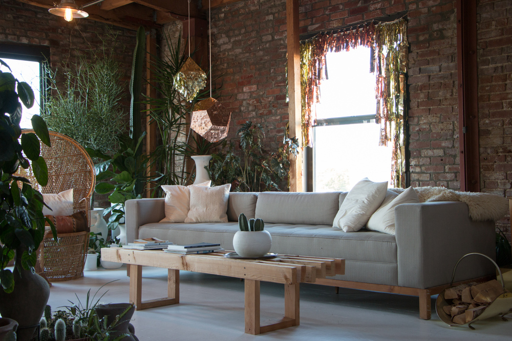 A modern boho living room. Just add living plants, neutral colors, wicker chairs, streamline couches, and  metallic pendant Piñatas by Prospect Goods .