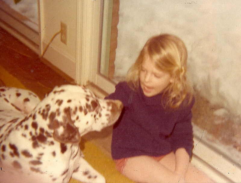 Me in deep discussion with my grandparents' chocolate Dalmatian, Nipper.