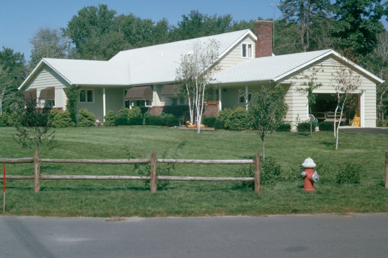 This is a photo from 1965 of the house where I grew up. That's me sitting on the front porch.