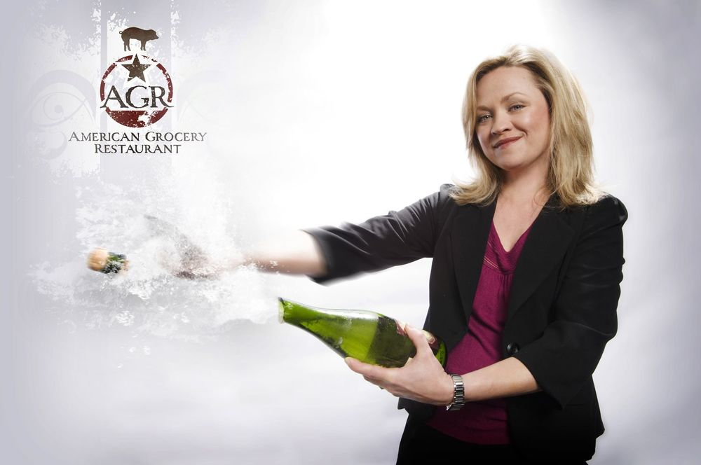 "Darlene Mann-Clarke Sommelier / Co-Owner Darlene Mann-Clarke, co-owner and sommelier at American Grocery Restaurant (AGR), brings creativity as well as extensive experience and knowledge to AGR's beverage program. Since opening the restaurant in 2007 with her husband, Joe Clarke, Darlene has developed a top-caliber wine program and further honed her skills in the art of craft cocktails. Her knowledge of seasonal house infusions, house-made bitters and tinctures has resulted in an award-winning cocktail list for AGR. Additionally, with over 17 years in the industry, Darlene is a certified sommelier through the Court of Master Sommeliers and has completed both course levels through the International Sommelier Guild.   The Greenwood, S.C., native moved to Greenville, S.C., from New York in 2006, where she worked for top restaurants such as MEGU Midtown; there, working closely alongside the wine director, she helped steward a wine list with over 300 bottles, which won a Wine Spectator ""Best Of"" Award.   Prior to her time in New York, Darlene lived in the West Coast's top food city – Los Angeles. Her time in California gave her access to wine-growing regions such as Napa, Santa Barbara and the Central Coast, where she cultivated friendships with small production winemakers. These relationships have made her a staunch advocate of ""farmer-made"" over ""factory-made"" wines. While Darlene moved to Los Angeles to pursue her passion for theatre and acting, her time spent at fine dining establishments such as Chadwick and Table 8 ignited her passion for the culinary world and wines.   A stunning wine and cocktail menu are not the only benefits Darlene has provided to AGR. In her free time, she loves crafting and home décor, which has resulted in the unique burlap curtains hanging near the restaurant's kitchen doors. She also enjoys traveling; she and Joe create trips around must-try restaurant locales. Darlene holds a MFA in Theatre from Southern Methodist University and a BA in Theatre from the University of South Carolina. Her acting talent and passion remains today, and you'll find Darlene performing for film and television roles when her schedule allows."