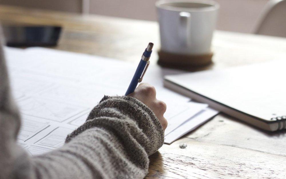 woman-writing-at-table-e1490638811177.jpg