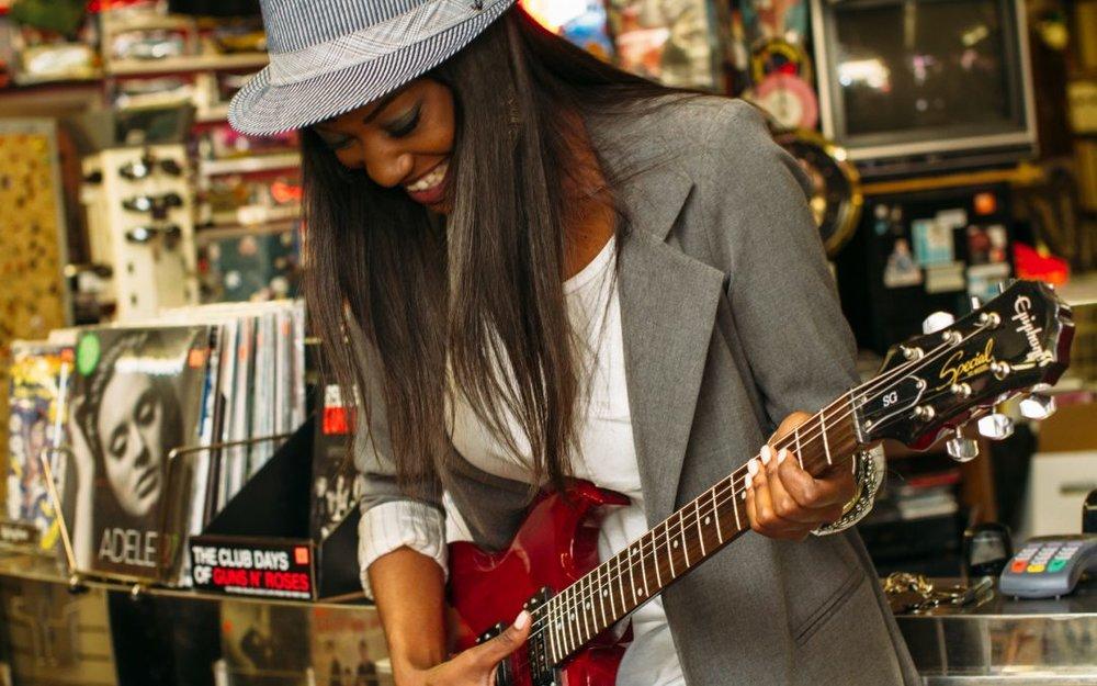 black-woman-playing-guitar.jpeg