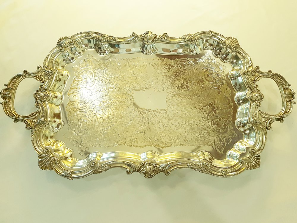 "EXQUISITE SERVING TRAY   25.5"" X 14.5""  Excellent condition. Large Silver tray. It has 4 feet raising the tray 1.5"" above the table. Beautiful design on tray. It  weighs 7.5 pounds.   View more photos of this item    Price upon request.  Private viewing by appointment."