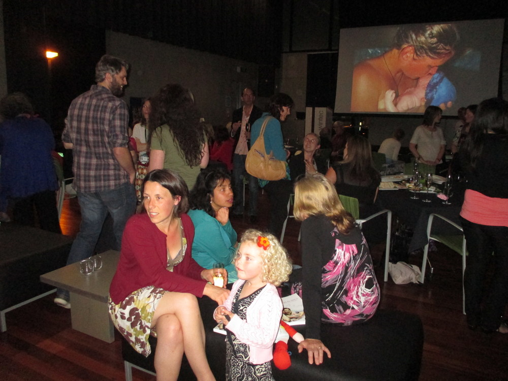 A couple of the many wonderful Peachgrove Playcentre mums who attended the launch, Liza and Teresa. On the screen in the background is a beautiful image from the book of Meghan with newborn Nikau.