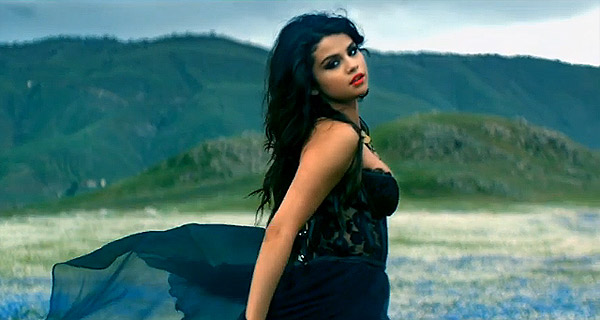 "Selena Gomez, in a photograph from her music video ""Come & Get It."" Here, it seems apparent that she is trying to make it very difficult to determine, exactly, what the ""it"" is."