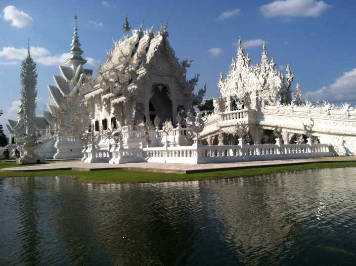 "Wat Rong Khun, aka ""The White Temple,"" channels Disney World's Magic Kingdom. Minus the fairytale."