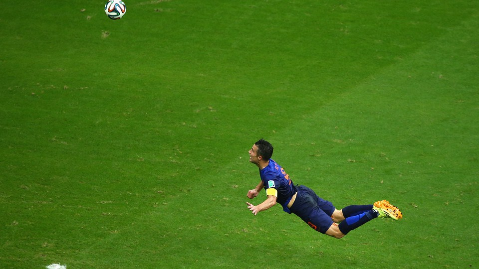 Robin van Persie, soaring. (Photo by Jeff Gross/Getty Images)