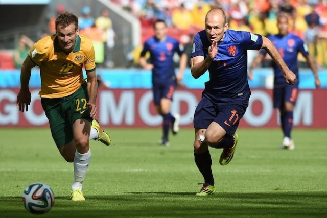 Arjen Robben, in blue, leading the Dutch dash for the glory of orange.