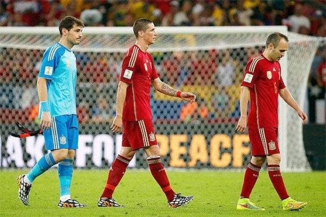 Iker Casillas, Fernando Torres and Andres Iniesta of Spain, walking not-so-tall.