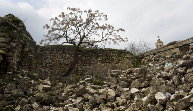 Photo:   Haaretz  .  The ruins of Biram ,  an Arab Christian village in Galilee destroyed by the Israel Defense Forces in 1953. In 1948, the residents—including  Elias Chacour —were expelled, taking refuge in a neighboring village.