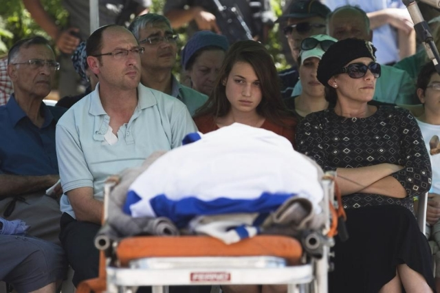 Israeli eyes. A sister (center) mourns her teenage brother, who was murdered by Palestinians in June.  Photo:  Ronen Zvulun/Reuters.