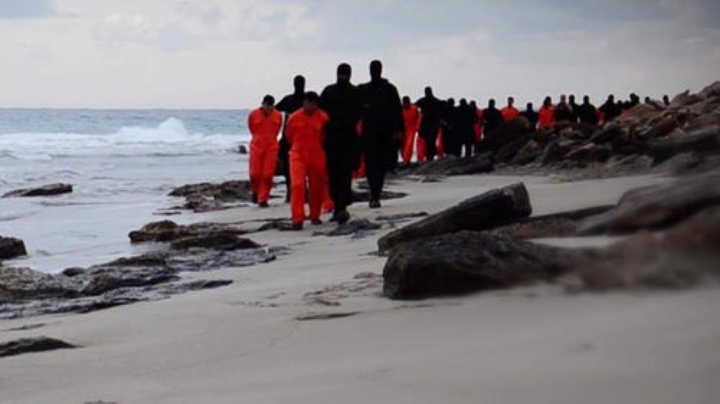 Members of the Islamic State lead a group of Egyptian (Coptic) Christians along a beach near Tripoli, Libya, to be executed. Photo: AFP/Getty Images.