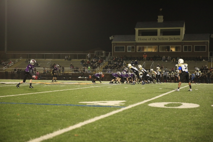 Here, Camden (middle of the photo) lines up as the Tight End on the right side of the Purple Cats offense.