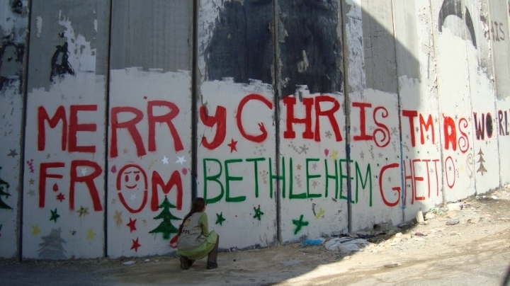 Israel's 440-mile wall through the West Bank  cuts off Bethlehem .