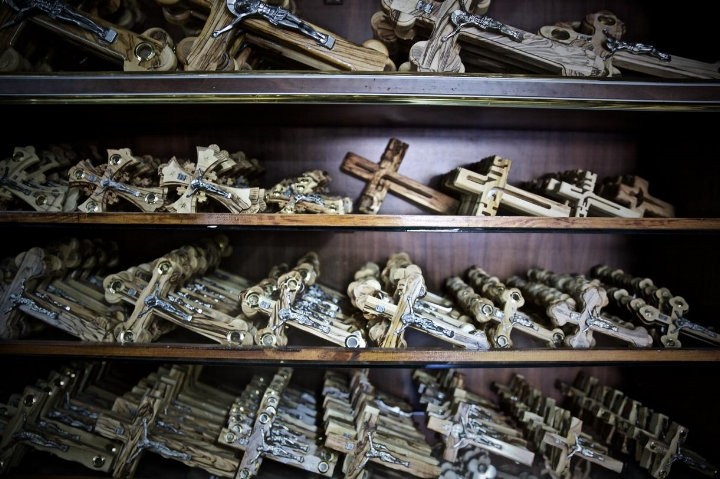 Shelves of crosses line a shop near Manger Square in Bethlehem.    Photo: Harriet Salem / VICE News (2015).
