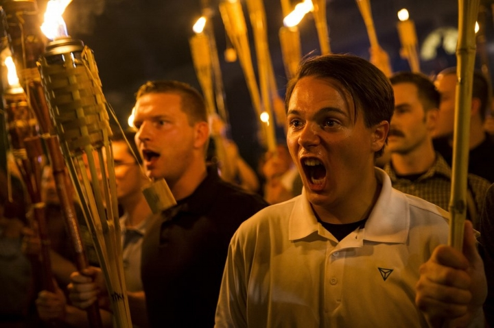 "A now-iconic image from the ""alt-right"" or far-right's warmup Unite the Right demonstration on the campus of the University of Virginia on August 11.    Photo: Getty Images."