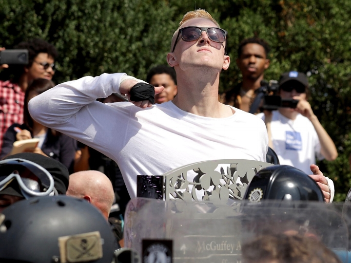 A white nationalist demonstrator struck a defiant pose at the Unite the Right rally in Charlottesville.    Photo: Getty Images.