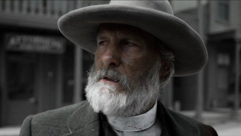 """In the original Netflix series  """"Godless""""  (2017), Jeff Daniels plays Frank Griffin, a thieving, vengeful, murdering outlaw who terrorizes New Mexico in the 1880s."""