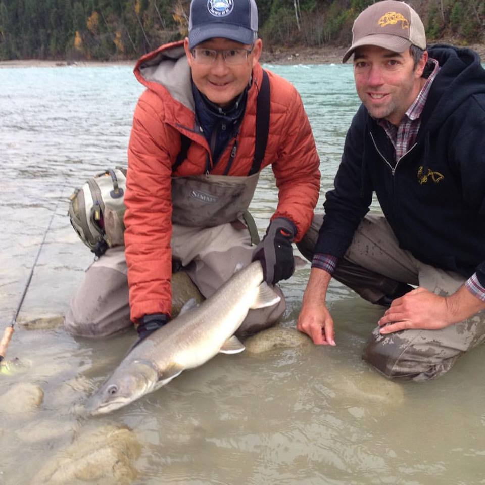 Brian Chan holding a nice bull trout on the Upper Columbia River